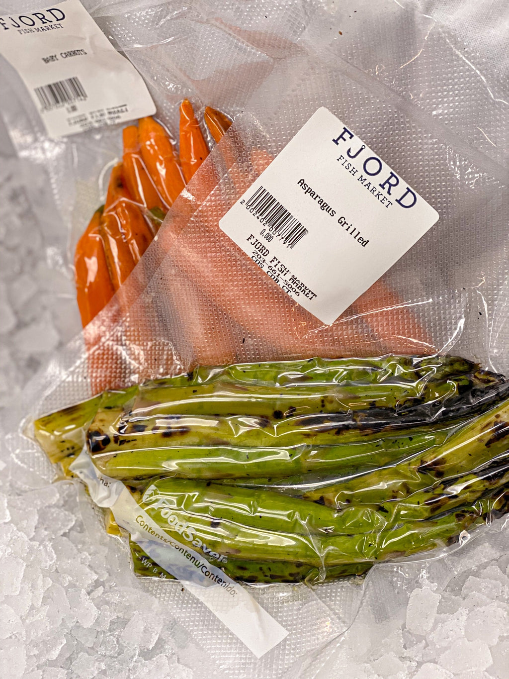 pack of asparagus and pack of carrots