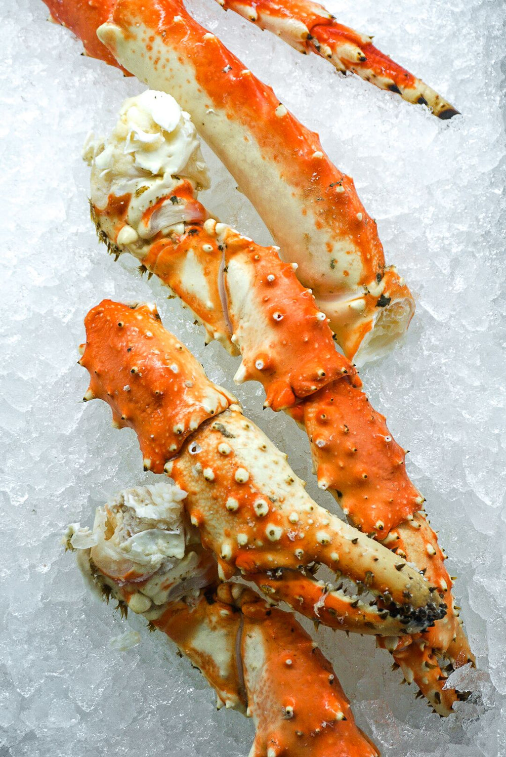 a stack of alaskan king crab legs