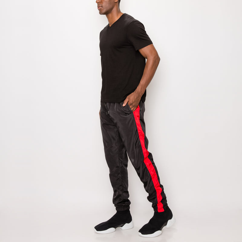 STRIPED WINDBREAKER TRACK PANTS - BLACK/RED