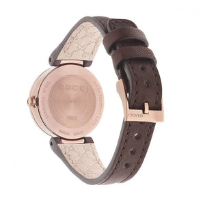 "Montre Gucci ""Interlocking"" PVD Bronze fond de boite"