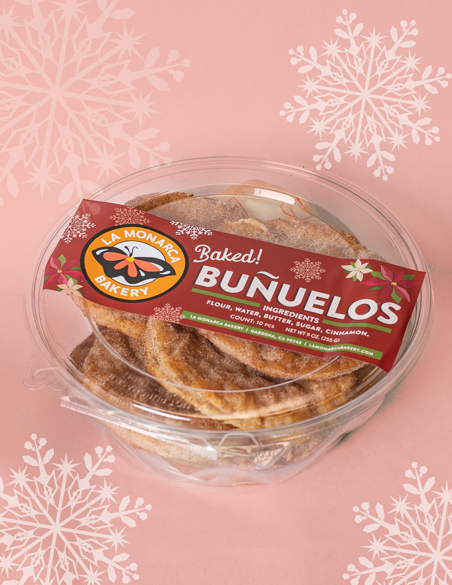bunuelos pastries in package la monarca bakery los angeles pink background with snowlfakes