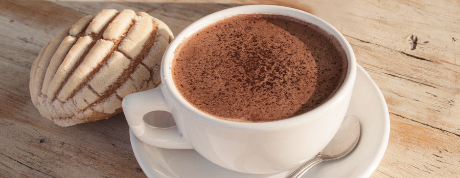 hot chocolate in mug with concha