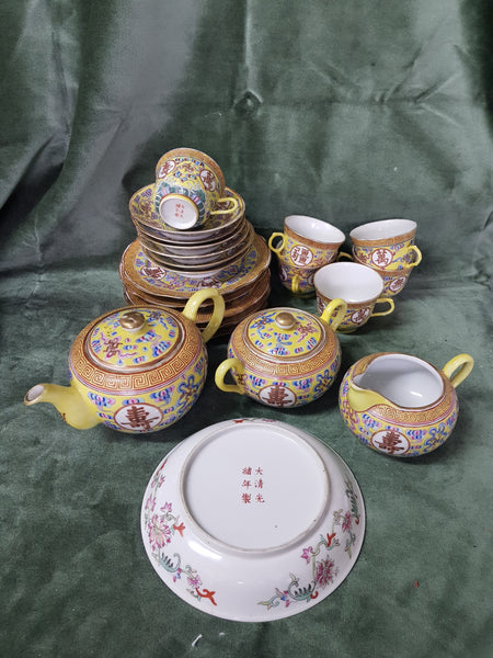 c1875-1908 Canton yellow ground tea-set Guangxu mark and period C19th comprising teapot/jug/bowl, 6 cups/saucers/plates and sweet meat dish, 22 pieces, bowl 19cm dm, teapot 12cm tall, plates 18cm dm, creamer 8cm tall #216