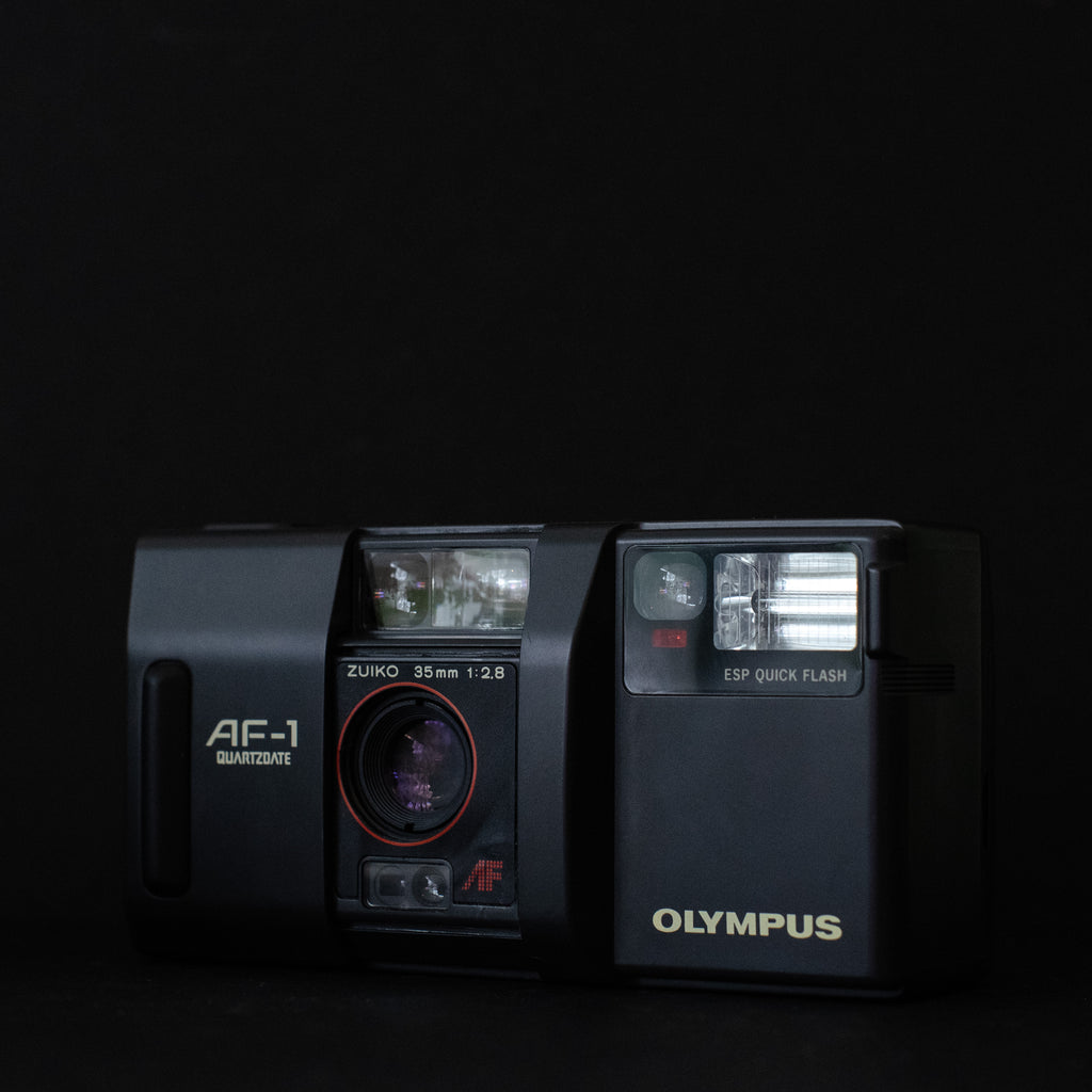 Olympus Af-1 with tele converter attachment