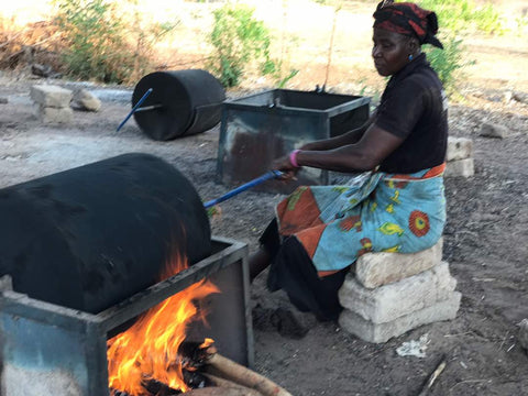 Woman roasting crushed shea nuts