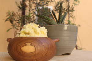 raw unrefined in an african bowl on the table.  made from shea nuts