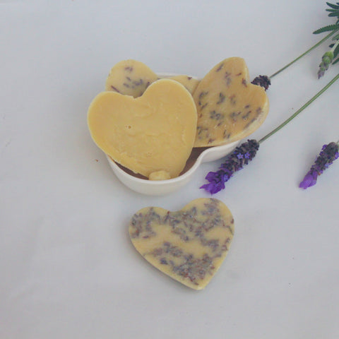 Handmade lotion bars made with coconut oil, cocoa butter, shea butter and lavender essential oil and flowers.