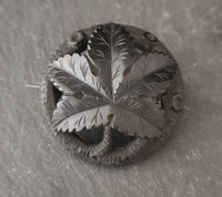 Antique jet maple leaf brooch