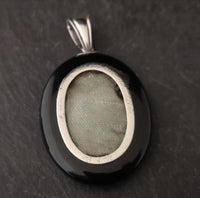 Victorian onyx and silver mourning locket