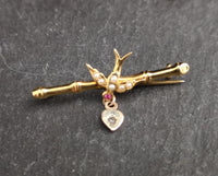 Antique Irish 9ct gold swallow brooch, Ruby, pearl and diamond