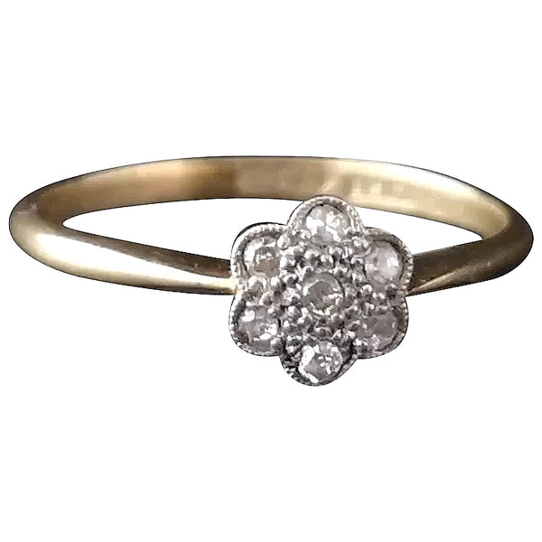 Antique diamond daisy ring, 18ct gold and platinum