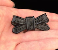 Victorian Whitby jet bow brooch, forget me not