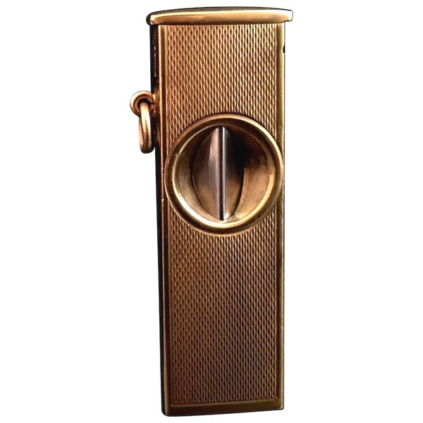 Vintage 9ct gold cigar cutter, engine turned
