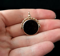 Antique 9ct Rose gold swivel fob, onyx