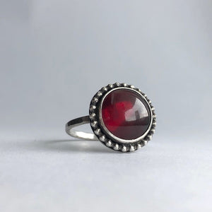 carla merino studio jewelry handcrafted in miami sterling silver ring with handcut garnet january birthstone
