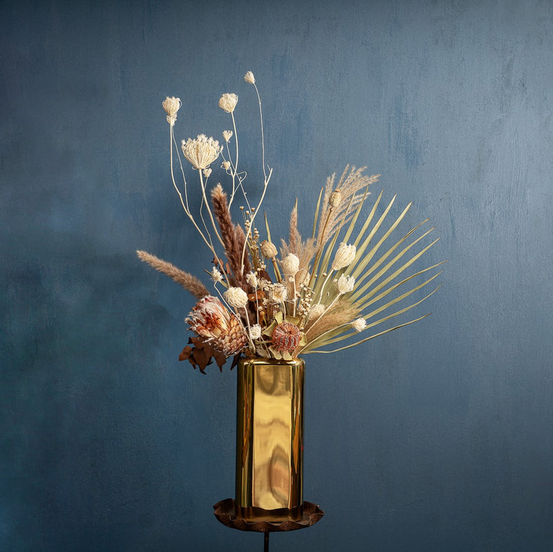 NUDE Layers Vase in lead free crystal with shiny gold finish, presented with a dried flower arrangement of soft, neutral and matte tones, created by Grace & Thorn