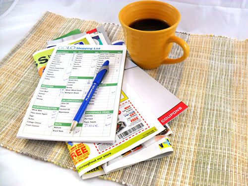 Coffee cup on the table with GOLO shopping list