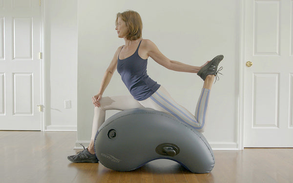 Woman stretching on aerotrainer