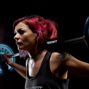 Girl weightlifting using olympic bar pad - Teknifit.store