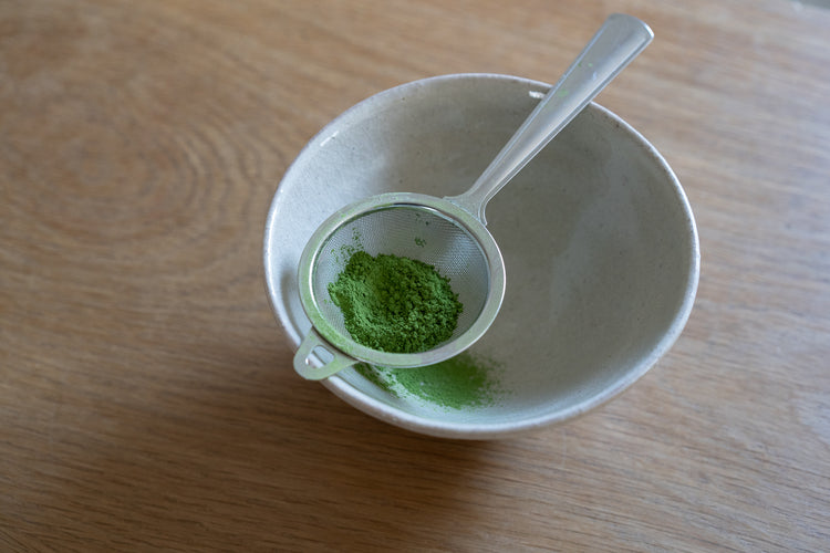 Matcha tea strainer in a bowl view
