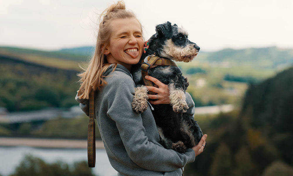 Happy dog owner photo by Samuel Girven on Unsplash