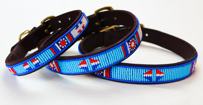 https://www.facebook.com/pg/COLLART.ACCESSORIES/shop/?ref=page_internal Hand made leather covered in beads, blue, red and white accents. Quality dog collar for all different sizes. Dog collar made from free grazing cattle and recycled brass. Beautiful dog design.