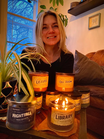 Customer Spotlight Janna sitting in front of Pour & Penchant 3 wick scented candles