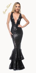The perfect black evening dress flecked with sequins