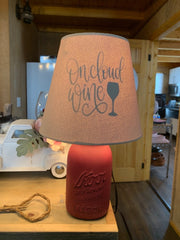 Lamp shade with lamp on