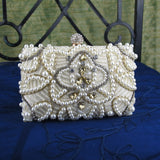 Embellished Clutch In Cream