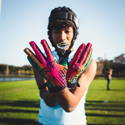DRIP Rev 3.0 Football Receiver Gloves - 7 on 7 Youth Football Player Showcasing Gloves