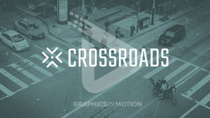 "The word ""crossroad"" boldly overlays a view from above of people, cars, bikes at a city intersection."