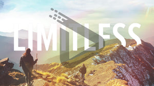 "Hikers on a misty mountain ridge, complete with a faint rainbow, act as the backdrop to the bold words ""Limitless""."