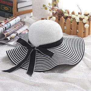 Summer straw hat in nautical style