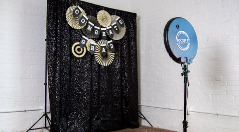 Congrats Grad Party Banner with Fan Decor on Black Sequin Photo Booth Backdrop
