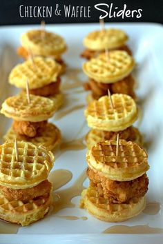 8 brunch sliders on a white plate made from mini Eggo waffles with chicken bites and honey butter