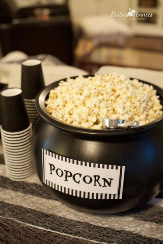 plastic halloween prop cauldron filled with popcorn