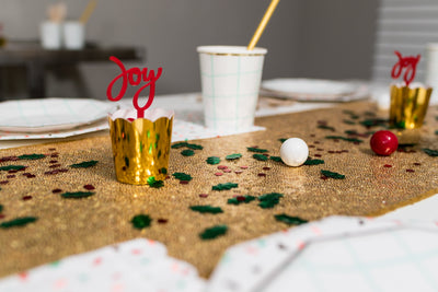 Holiday Party Treat Cups and Tableware on Gold Sequin Runner