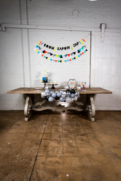 Super Hero Party Table with Balloon Garland