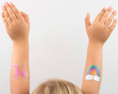unicorn & rainbow temporary tattoos on little girl