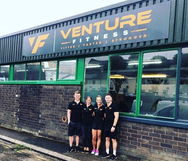 Us standing in front of Venture Fitness