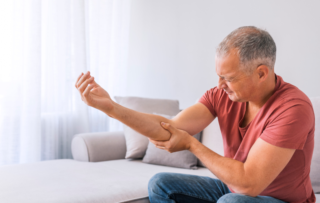 older man with elbow pain