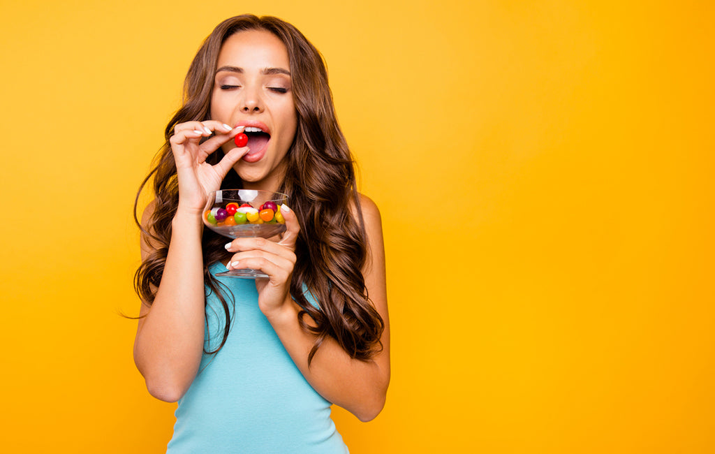 woman eating cbd edible candy