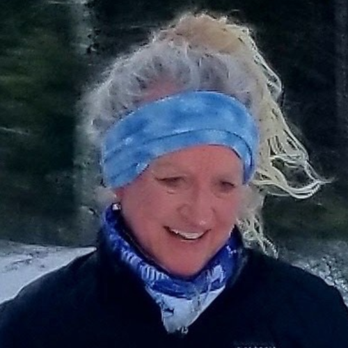 Woman triathlete smiling about CBD balm