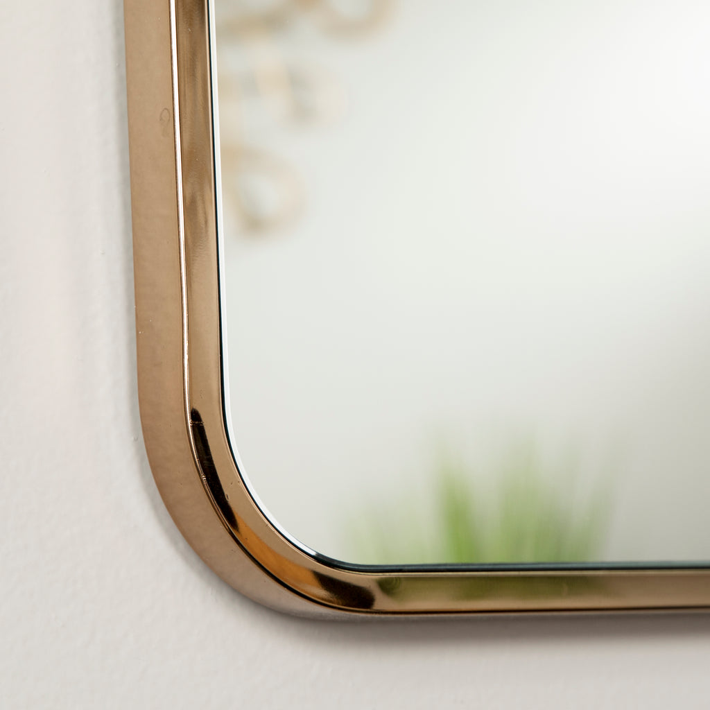 Close up of champagne gold metal frame.