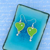 Shop LAVISHY handmade silver plated enamel forever young green heart with crystal accent earrings. A great gift for you or your girlfriend, wife, co-worker, friend & family. Wholesale available at www.lavishy.com with many unique & fun fashion accessories for gift shops and boutiques in Canada, USA & worldwide.