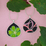 Shop LAVISHY handmade silver plated reversible flower & geometric pattern enamel necklace. A great gift for you or your girlfriend, wife, co-worker, friend & family. Wholesale available at www.lavishy.com with many unique & fun fashion accessories for gift shops and boutiques in Canada, USA & worldwide.