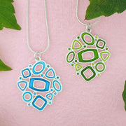 Shop LAVISHY handmade silver plated reversible geometric pattern enamel necklace. A great gift for you or your girlfriend, wife, co-worker, friend & family. Wholesale available at www.lavishy.com with many unique & fun fashion accessories for gift shops and boutiques in Canada, USA & worldwide.