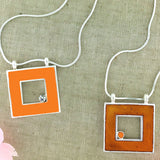 Online shopping for LAVISHY handmade silver plated reversible square enamel necklace. A great gift for you or your girlfriend, wife, co-worker, friend & family. Wholesale at www.lavishy.com with many unique & fun fashion accessories for gift shops and boutiques in Canada, USA & worldwide.