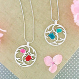 Shop LAVISHY handmade silver plated reversible tulips flower enamel necklace. A great gift for you or your girlfriend, wife, co-worker, friend & family. Wholesale available at www.lavishy.com with many unique & fun fashion accessories for gift shops and boutiques in Canada, USA & worldwide.
